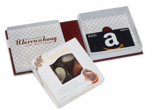 Amazon.de Box mit Geschenkkarte und kostenlosen Pralinen
