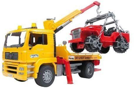 Bruder 02750 - MAN TGA Abschlepp-LKW mit Geländewagen [Amazon Prime]