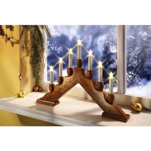 Weihnachtlich bei Amazon.de  - TV Das Original Kabelloser LED Kerzenzauber Schwibbogen Lichterbogen Kerzenbogen Classico Holz für 9,95€