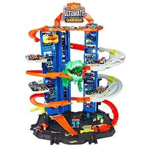 Hot Wheels Ultimate Garage mit T-Rex-Angriff inkl. 2 Spielzeugautos für 65,15€ (Amazon ES)