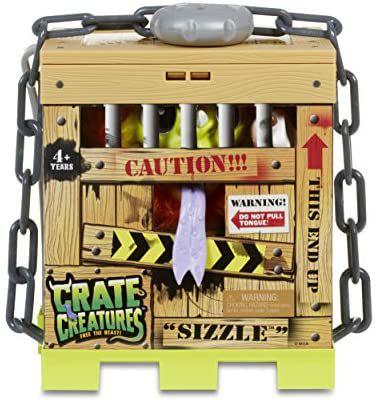 MGA Crate Creatures Surprise, Sizzle Monster-Plüschtier im Käfig, mit Licht und Sound [Amazon Prime]