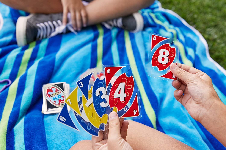 [ Thalia.de ] Mattel Games - UNO® H2O To Go - Uno Kartenspiel für unterwegs ( wasserfest & schmutzabweisend )